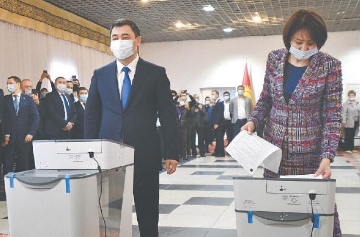Kyrgyzstan's President Sadyr Japarov and his wife Aigul Asanbaeva cast their ballots at a polling station in Bishkek on Sunday.—AP