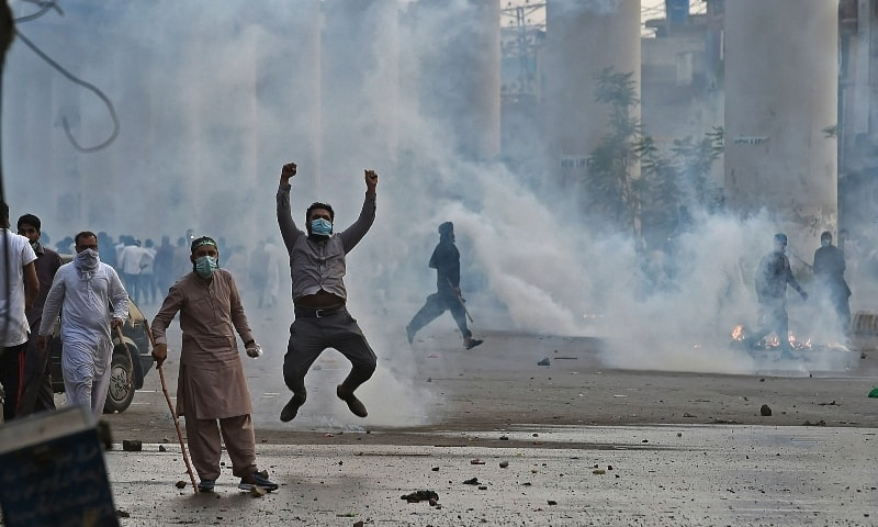Police use tear gas to disperse supporters of Tehreek-i-Labbaik Pakistan during a protest in Lahore on April 12. — AFP