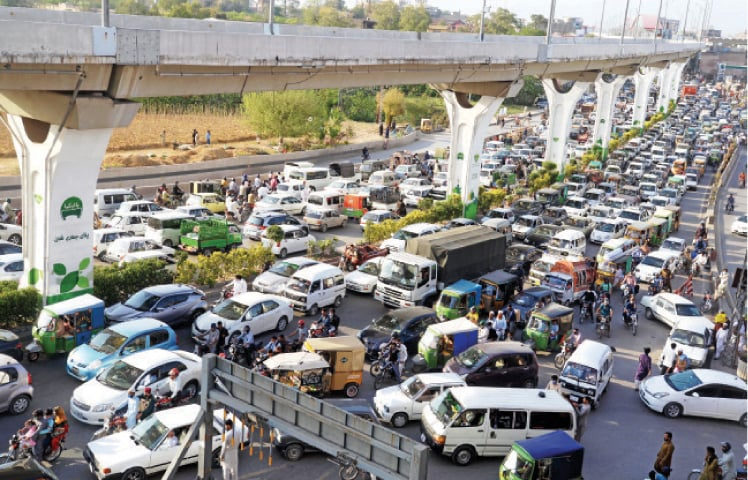 Traffic gridlock is seen on Murree Road due to the protest staged by TLP activists on Monday. — Photo by Mohammad Asim