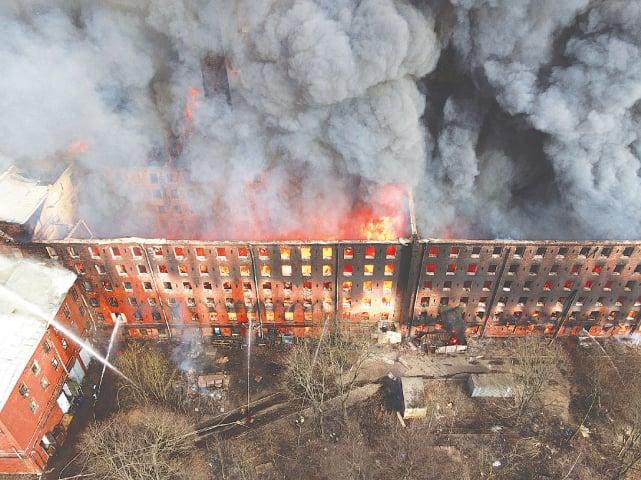 A CLOUD of smoke billows from the Nevskaya Manufaktura factory on Monday.—Reuters
