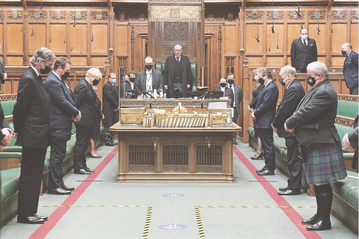 Members of Britain's parliament observe a minute of silence in the House of Commons to pay tribute to Prince Philip.—AFP
