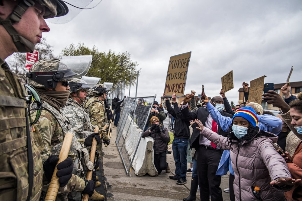 Protesters confront National Guardsmen on Monday at the Brooklyn Center Police Department in Minneapolis as they protest the fatal police shooting of Daunte Wright. — AP