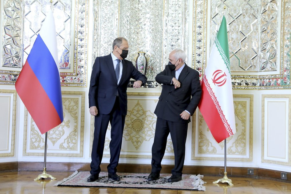 In this photo released by the Iranian Foreign Ministry, Iranian Foreign Minister Mohammad Javad Zarif, right, and Russian Foreign Minister Sergey Lavrov greet each other by touching elbows and wear face masks prior to their talks in Tehran, Iran on Tuesday. — AP