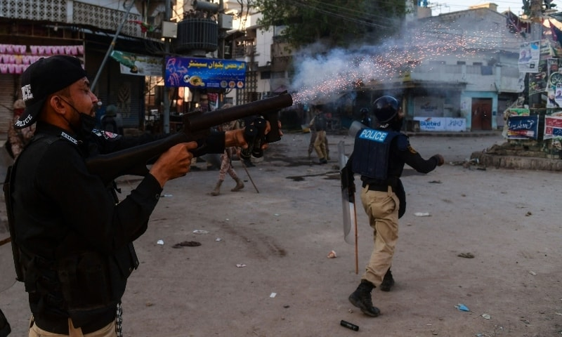 Police personnel fire teargas shell towards supporters of Tehreek-e-Labbaik Pakistan during a protest in Karachi on April 13. — AFP