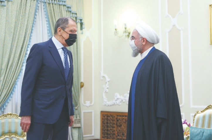 Iranian President Hassan Rouhani meets Russia's Foreign Minister Sergey Lavrov on Tuesday.—Reuters
