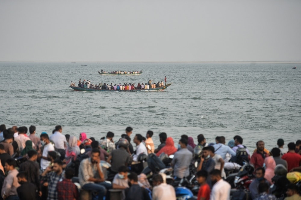 People leave the city on a ferry as authorities ordered eight-day lockdown to contain the spread of the coronavirus, in Munshigamj district, about 70 km from Dhaka on April 13. - AFP