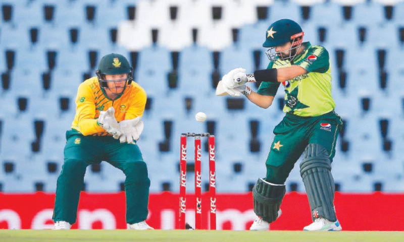 CENTURION: Pakistan captain Babar Azam cuts as his South African counterpart Heinrich Klaasen looks on during the third Twenty20 International at the SuperSport Park  on Wednesday.—AFP