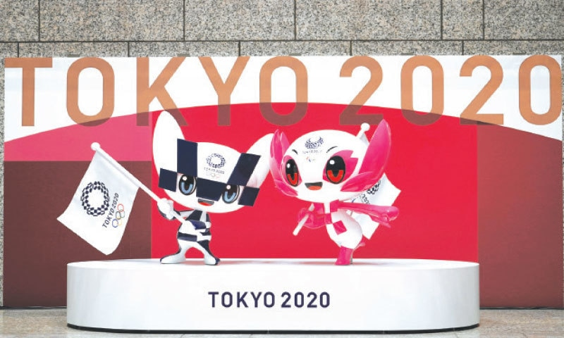 TOKYO: The statues of Miraitowa (L) and Someity, official mascots for the Tokyo 2020 Olympics and Paralympics, are unveiled to mark 100 days before the start of the Olympic Games at the Tokyo Metropolitan Government building on Wednesday.—AP