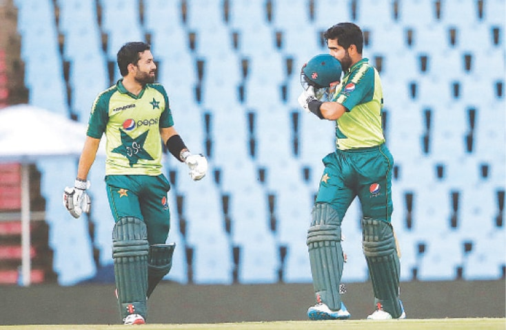 CENTURION: Pakistan's captain Babar Azam (right) celebrates after scoring a century as Mohammad Rizwan looks on during the third Twenty20 against South Africa on Wednesday. Babar Azam gave a batting masterclass to lead his side to a nine-wicket win as Pakistan chased down a challenging target of 204 with two overs to spare. —AFP