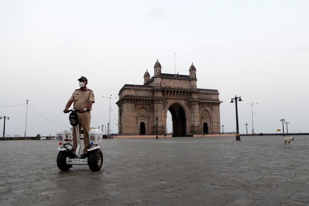 A security person patrols at Gateway of India in Mumbai on April 14. — AP