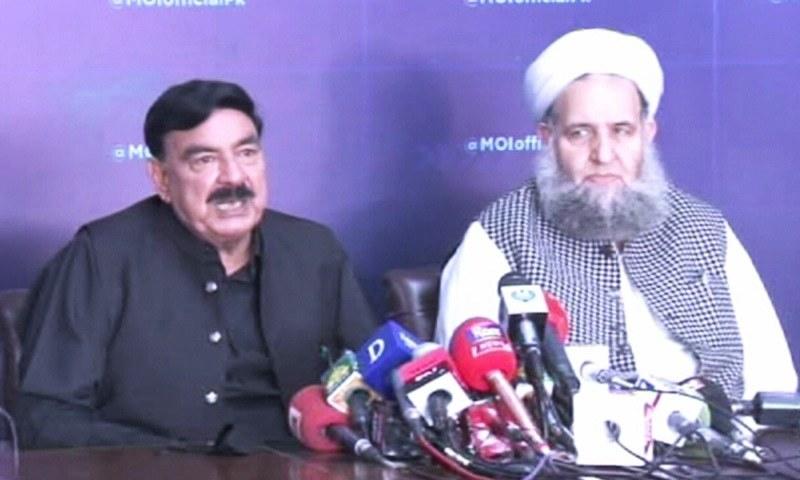Interior Minister Sheikh Rashid and Minister for Religious Affairs Noorul Haq Qadri address a press conference on Thursday. — DawnNewsTV