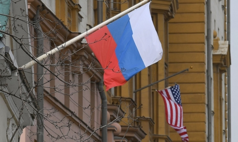 A Russian flag flies next to the US embassy building in Moscow on April 15, 2021. — AFP