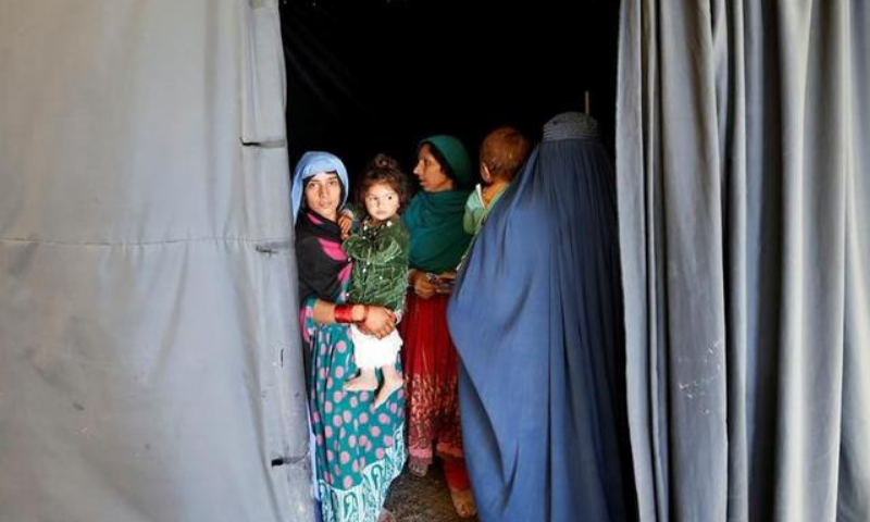 Afghan women arrive at a United Nations High Commissioner for Refugees (UNHCR) registration centre in this file photo. — Reuters