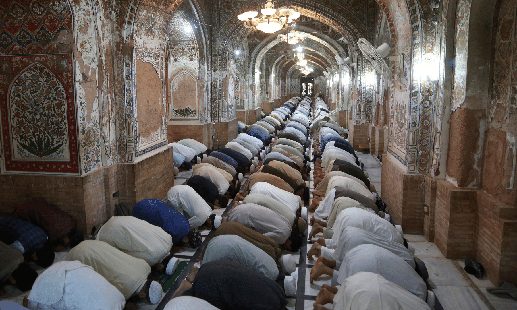 Muslims perform mid-day prayers during Ramazan, at the historic Mohabat Khan Mosque, in Peshawar on Wednesday. — AP