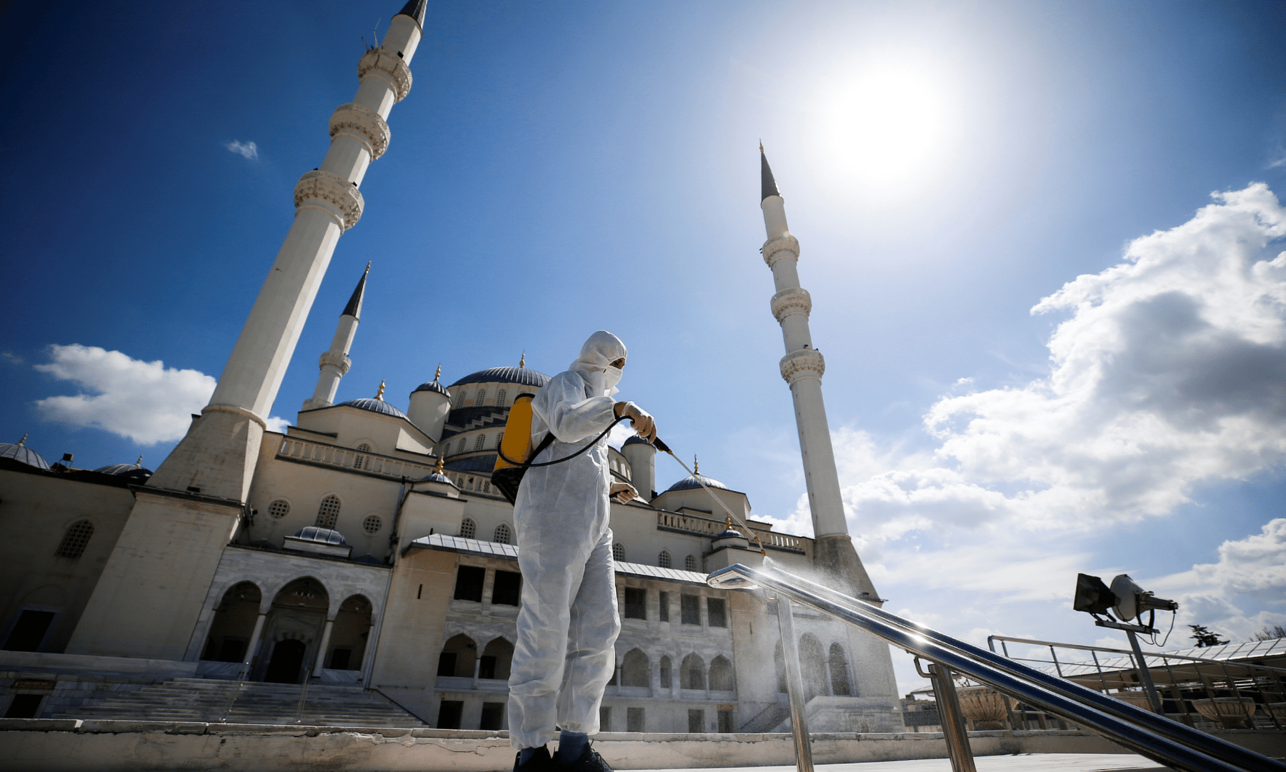 A municipality worker in a protective suit disinfects the Kocatepe Mosque to prevent the spread of the coronavirus, during Ramazan in Ankara, Turkey. — Reuters