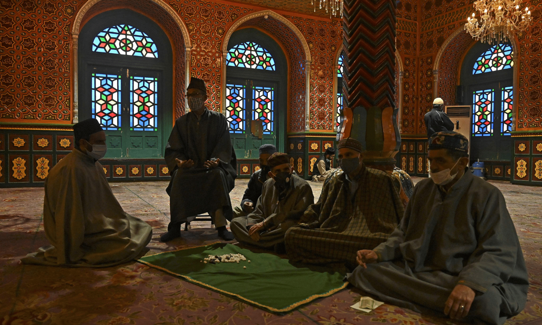 Muslim devotees pray at a shrine during Ramazan in Srinagar on Thursday. — AFP