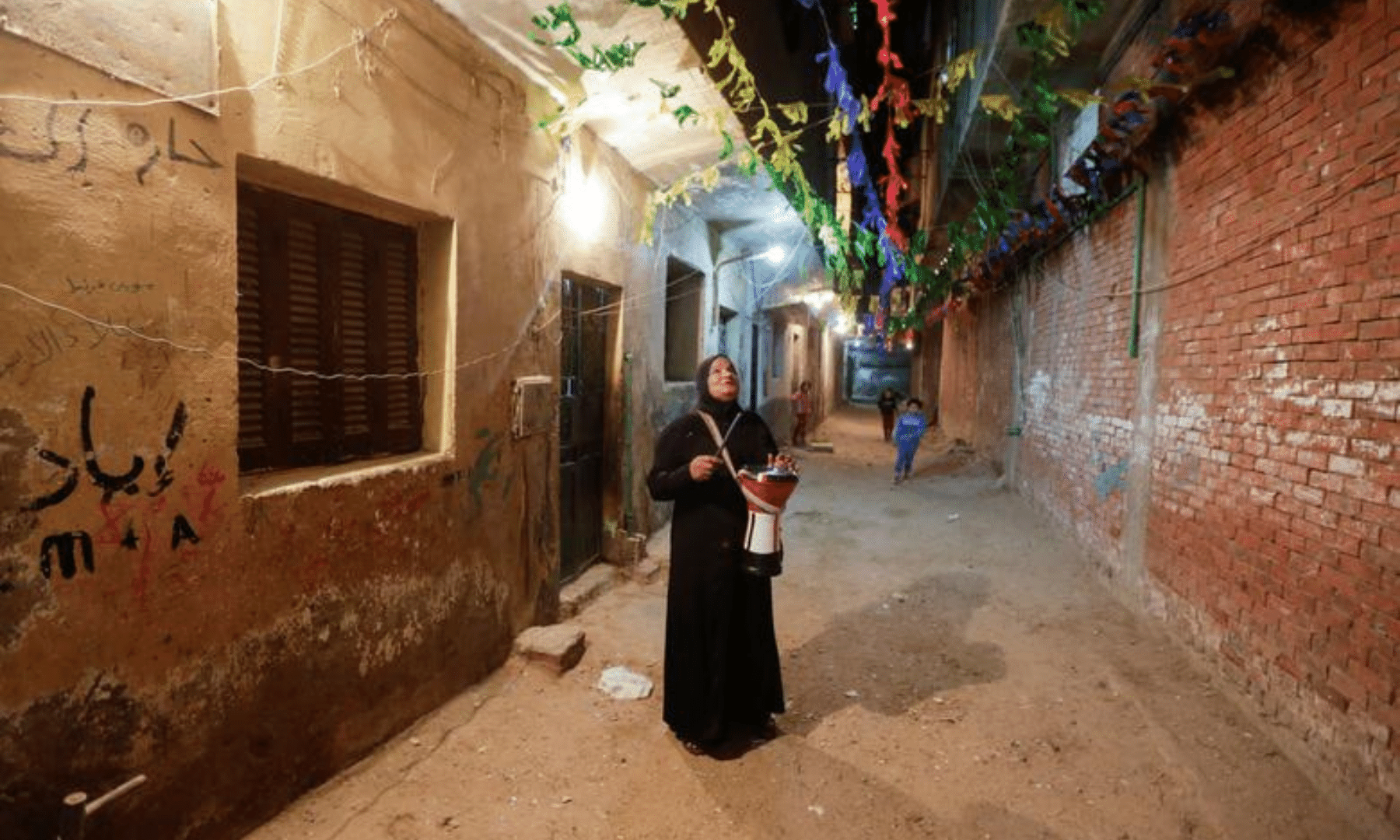 Hajja Dalal, a 46-year-old Mesaharati, beats a drum to wake up Muslims to have the pre-dawn meal before they start their long-day fast during Ramazan at Maadi neighbourhood in Cairo, Egypt on Tuesday. — Reuters