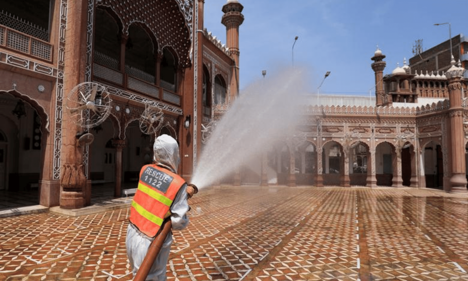A worker sprays disinfectant to sanitise a mosque ahead of Ramazan in Peshawar on Tuesday. — Reuters