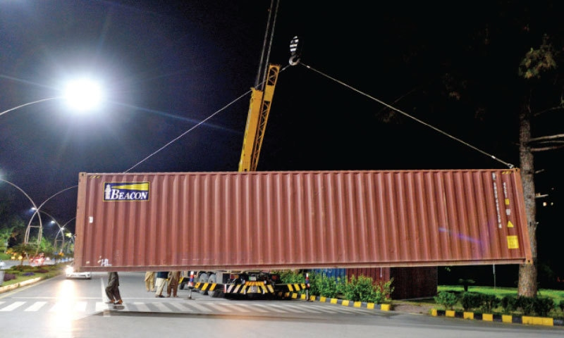 Local administration places a container in front of Serena Chowk in Islamabad as banned TLP plans protest after Friday prayers. — Photo by Mohammad Asim