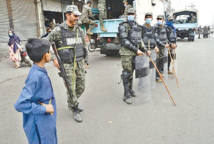 Rangers stand alert at Daroghawala Chowk after an operation against workers of Tehreek-i-Labbaik Pakistan. — White Star