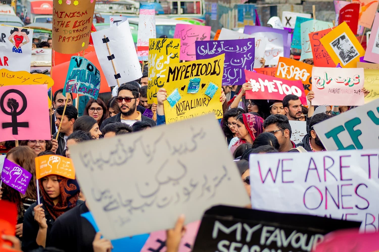 Aurat March participants holding placards.—Photo courtesy of Amnesty International