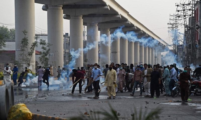 Police use tear gas to disperse supporters of Tehreek-i-Labbaik Pakistan (TLP) during a protest in Lahore on Monday. — AFP