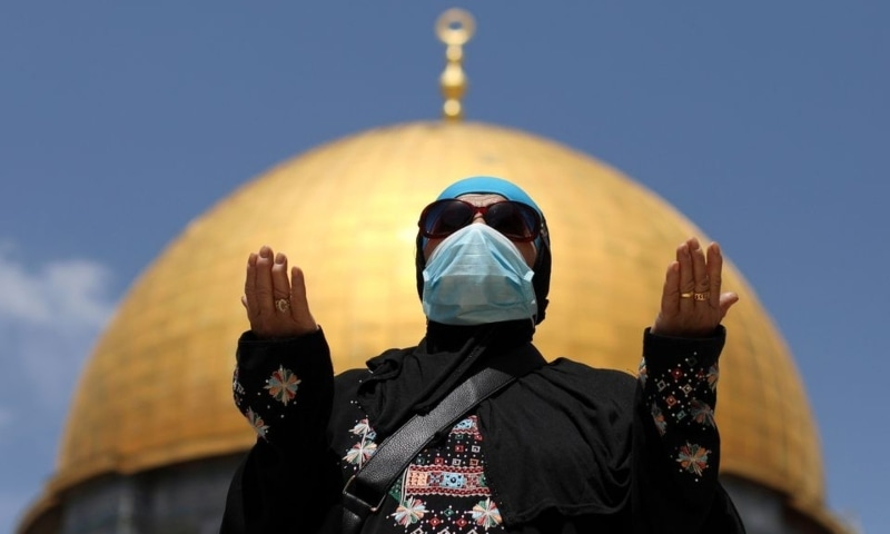 A Palestinian woman prays in front of the Dome of the Rock in the compound known to Muslims as Noble Sanctuary and to Jews as Temple Mount in Jerusalem's Old City, on the first Friday of the holy month of Ramazan, as Covid-19 restrictions ease in Israel, April 16. — Reuters