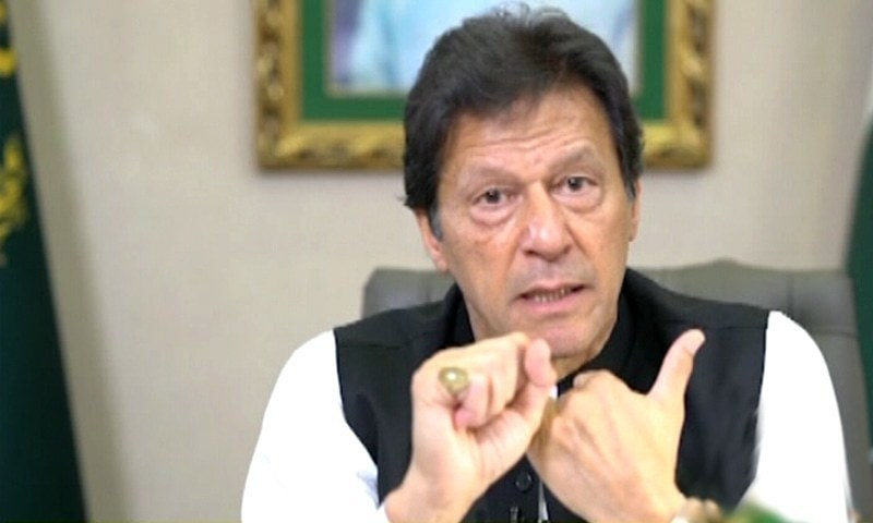 """Prime Minister Imran Khan on Saturday asked the governments of Western countries to apply the same standards and """"penalise those deliberately spreading their message of hate against Muslims"""" by disrespecting Prophet Muhammad (PBUH) in the same way that they had """"outlawed any negative comment against the Holocaust"""". — DawnNewsTV/File"""
