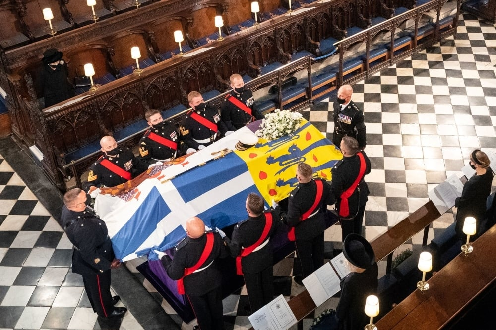 Britain's Queen Elizabeth II watches as pallbearers carry the coffin of the Britain's Prince Philip during his funeral at St George's Chapel on April 17. — Reuters