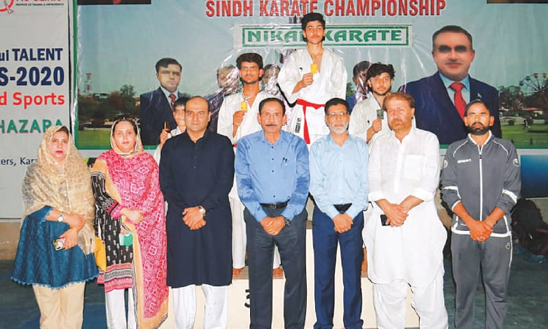 KARACHI: Position holders of the SSB Stability Sindh Karate Championship are seen with chief guest Muhammad Jahangir, Tehmina Asif and other offi cials.