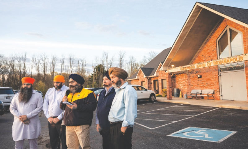 Leaders of the Sikh Satsang of Indianapolis addressing their grief in the parking lot of their temple in the city. — AFP