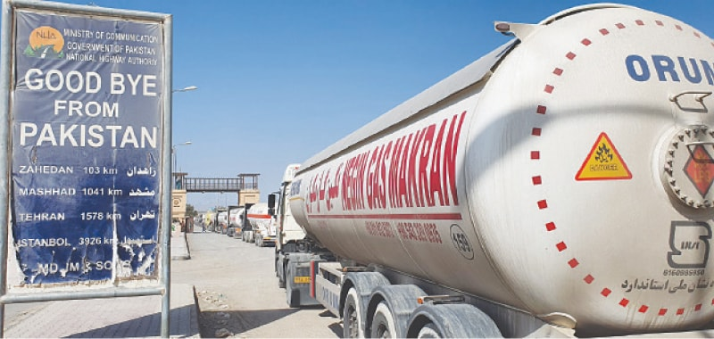 TAFTAN: Trucks and gas tankers wait at Pakistan Gate to enter Iran.—Photo by the writer