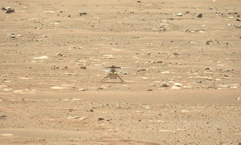 THIS NASA photo obtained on Sunday shows the agency's Ingenuity helicopter on Mars right after it successfully completed a high-speed spin-up test.—AFP