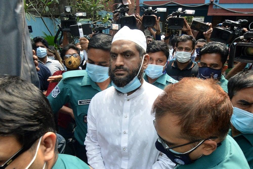 Police escort Mamunul Haque, a joint secretary of Hefazat-e-Islam, following his arrest in Dhaka on April 18. - AFP