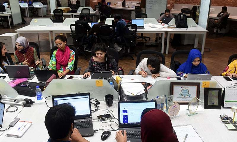 In this photograph taken on May 24, 2019, People work at their stations at the National Incubation Centre (NIC), a start-up incubator, in Lahore. — AFP/File