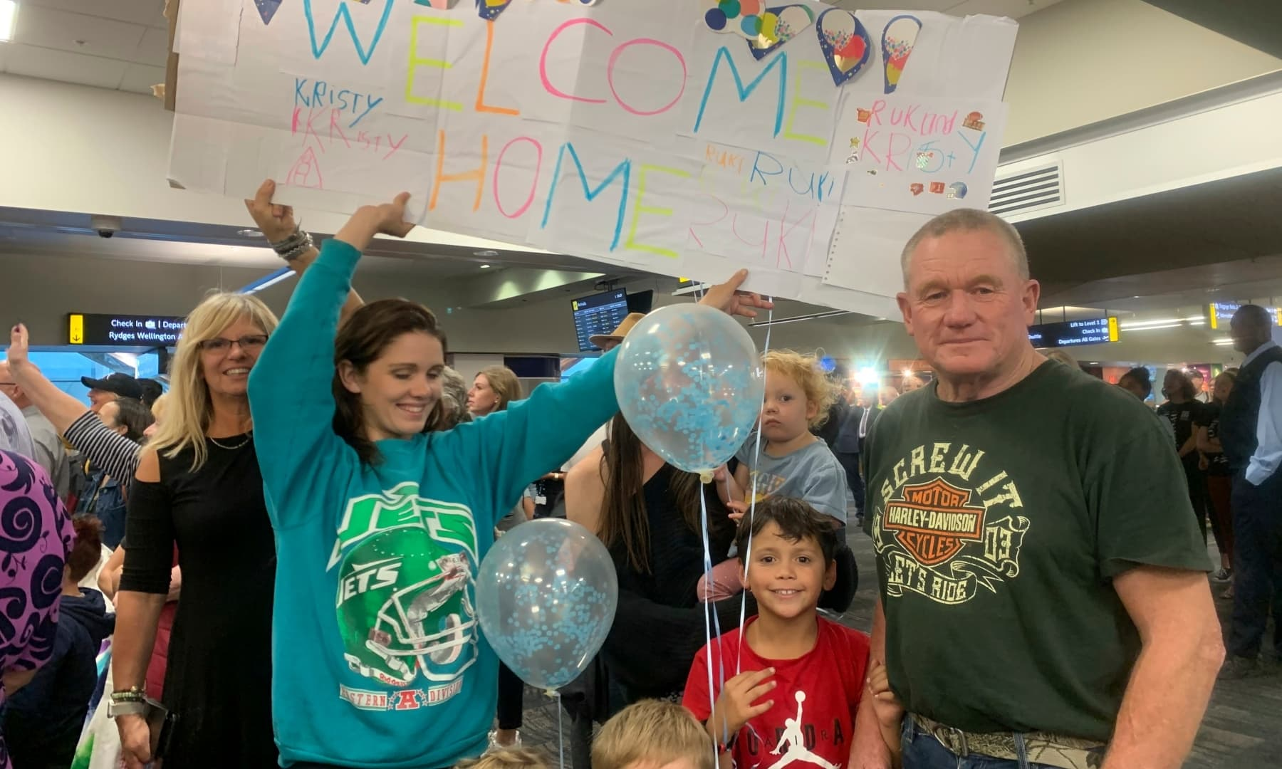 Danny Mather, right, and other family members wait at the Wellington International Airport for the arrival of Mather's pregnant daughter Kristy in Wellington, New Zealand, Monday. — AP