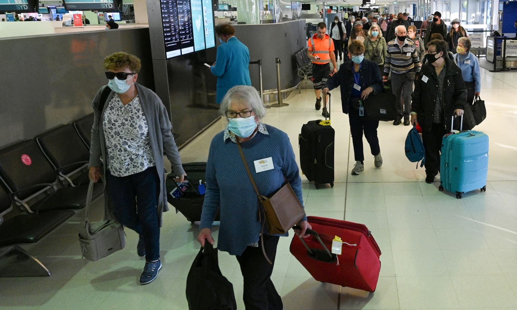 Travellers proceed to the check-in counters for New Zealand flights at Sydney International Airport on April 19, as Australia and New Zealand opened a trans-Tasman quarantine-free travel bubble. — AFP
