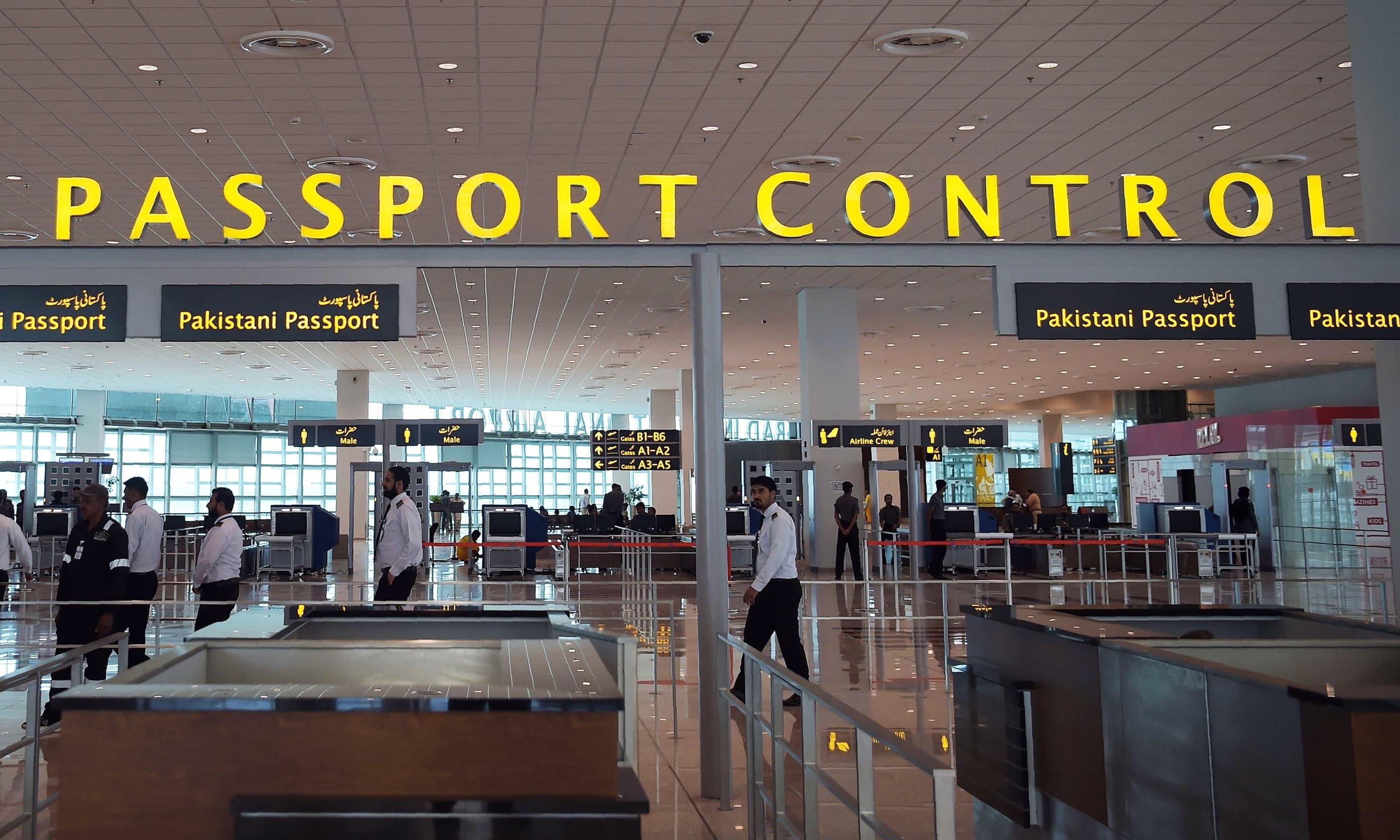 Pakistani airport staff walk through the Islamabad International Airport. — AFP/File
