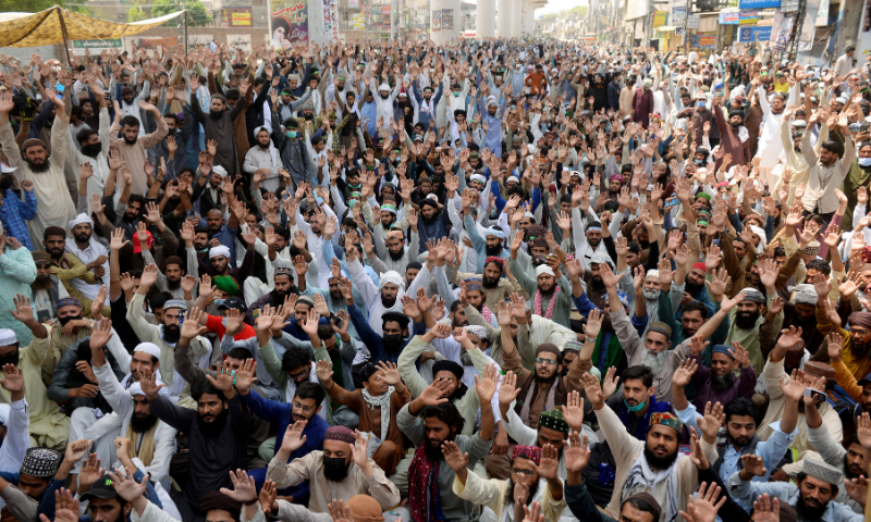 Supporters of the banned Tehreek-e-Labaik Pakistan (TLP) chant slogans during a protest in Lahore on Monday. — Reuters