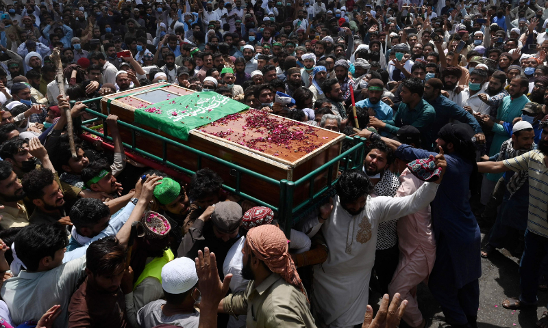 Supporters of the proscribed Tehreek-e-Labbaik Pakistan (TLP) party carry the coffin of a worker who was killed in a clash with security forces a day earlier. — AFP