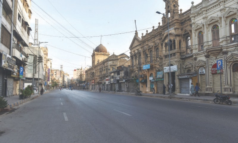 The usually bustling Zaibunnisa Street in Saddar bears a deserted look on Monday.—Fahim Siddiqi/White Star
