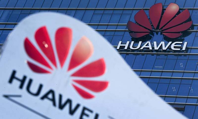This December 18, 2018, file photo, shows company signage on display near the Huawei office building at its research and development center in Dongguan, in south China's Guangdong province. — AP/File