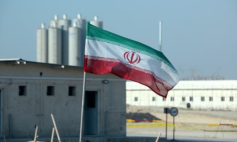 In this file photo taken on November 10, 2019, an Iranian flag flutters in Iran's Bushehr nuclear power plant, during an official ceremony to kick-start works on a second reactor at the facility. — AFP/File