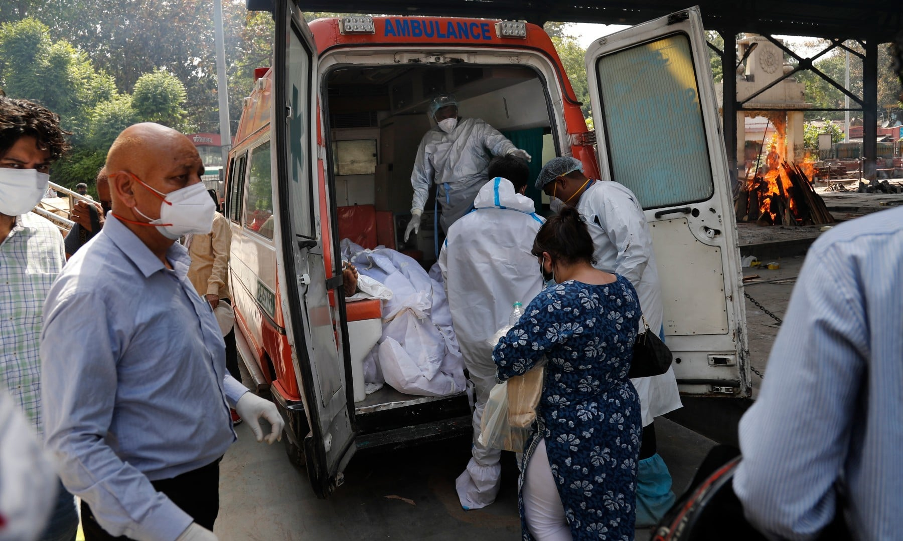 Health workers prepare to take out from an ambulance bodies of six people who died for cremation in New Delhi on April 19. — AP