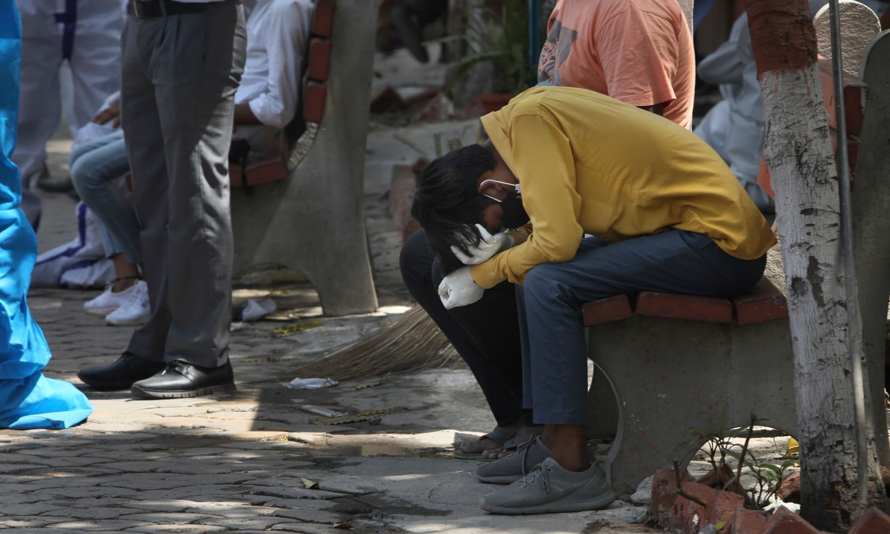 A relative of a person who died of Covid-19 reacts during cremation in New Delhi on April 19. — AP