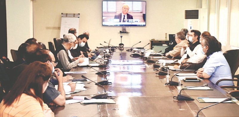 ISLAMABAD: Federal Minister for Finance and Revenue Shaukat Tarin and other officials pictured during a virtual meeting with World Bank's Managing Director (Operations) Axel van Trotsenburg at Finance Division on Tuesday.