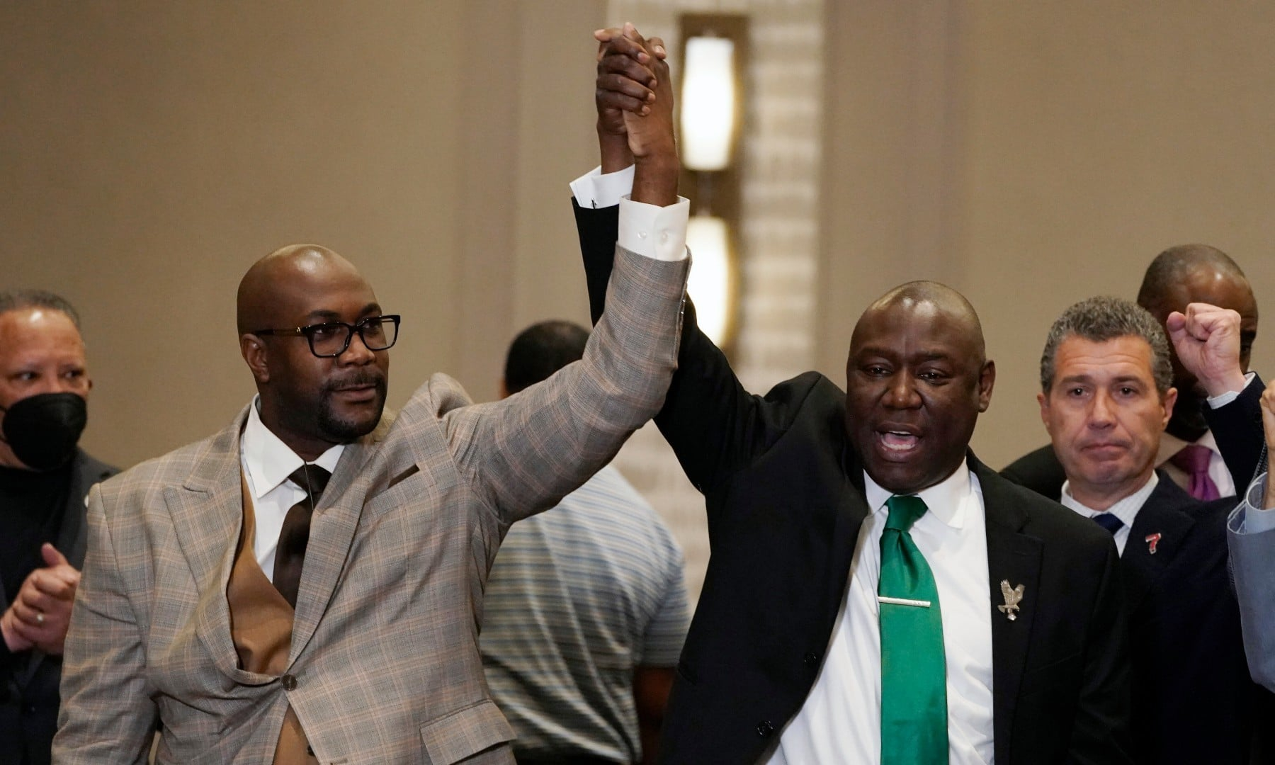 Philonise, left, and attorney Ben Crump react during a news conference after the guilty verdict was read in the trial of former Minneapolis police Officer Derek Chauvin on April 20. —  AP