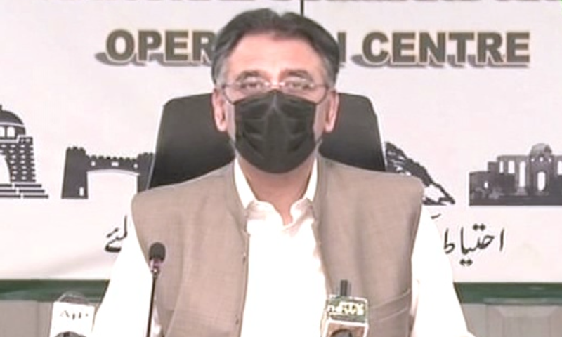 Minister for Planning, Development and Special Initiatives Asad Umar speaks to the media on Wednesday. — DawnNewsTV