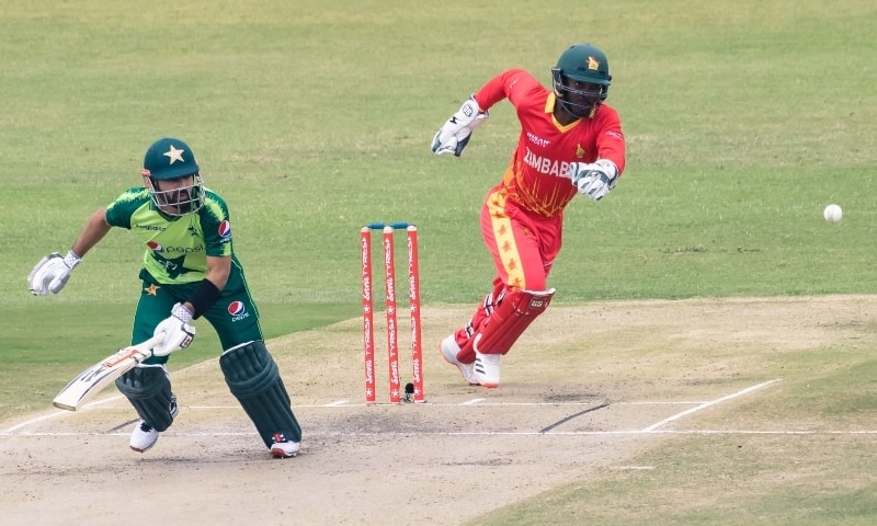 Mohammad Rizwan (L) runs between the wickets as Zimbabwe's wicketkeeper Regis Chakabva (R) fields during the first Twenty20 international between Zimbabwe and Pakistan at the Harare Sports Club in Harare on April 21. — AFP