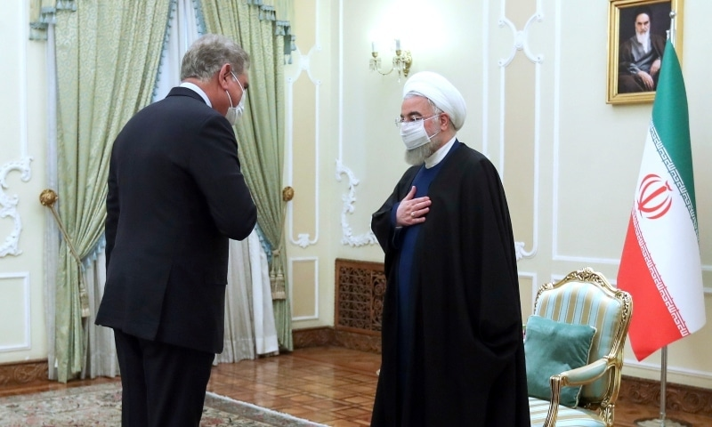 Iranian President Hassan Rouhani, right, welcomes Foreign Minister Shah Mahmood Qureshi for their meeting in Tehran, Iran, Wednesday, April 21. — Iranian Presidency Office via AP